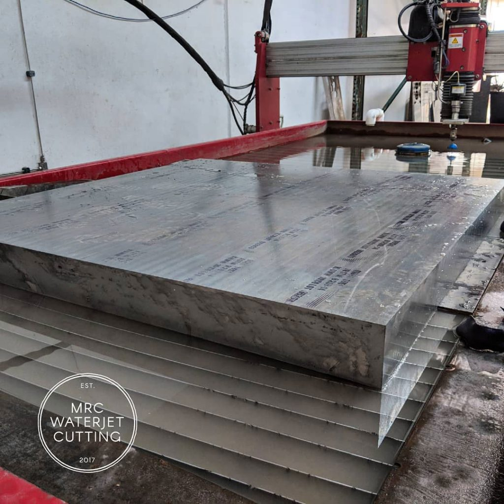 A 100mm thick 400kg piece of 6061 being divided up prior to machining. These will become stability fins on police and pilot boats.