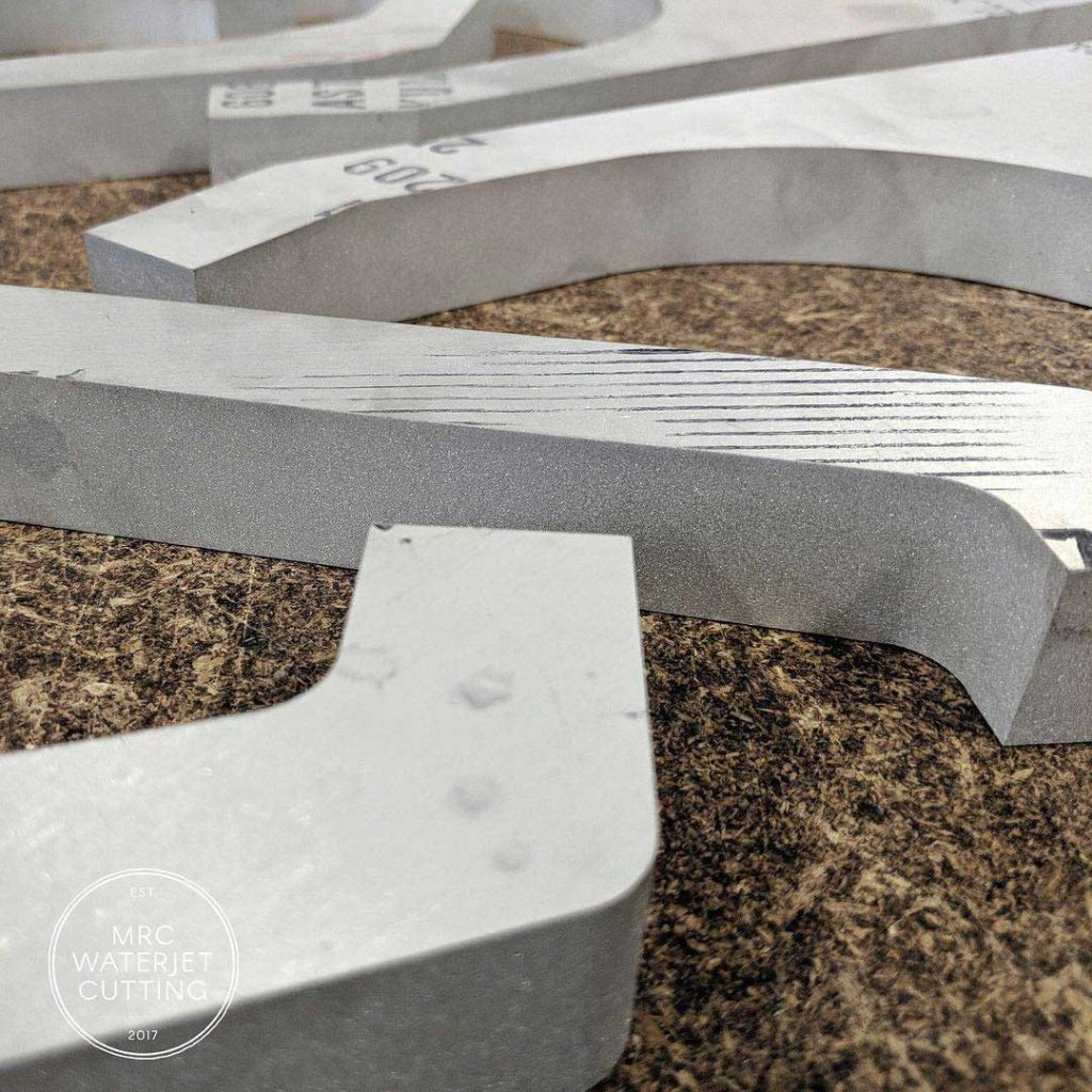6061 aluminium control arms cut from 20mm plate for a customers ultima GTR supercar
