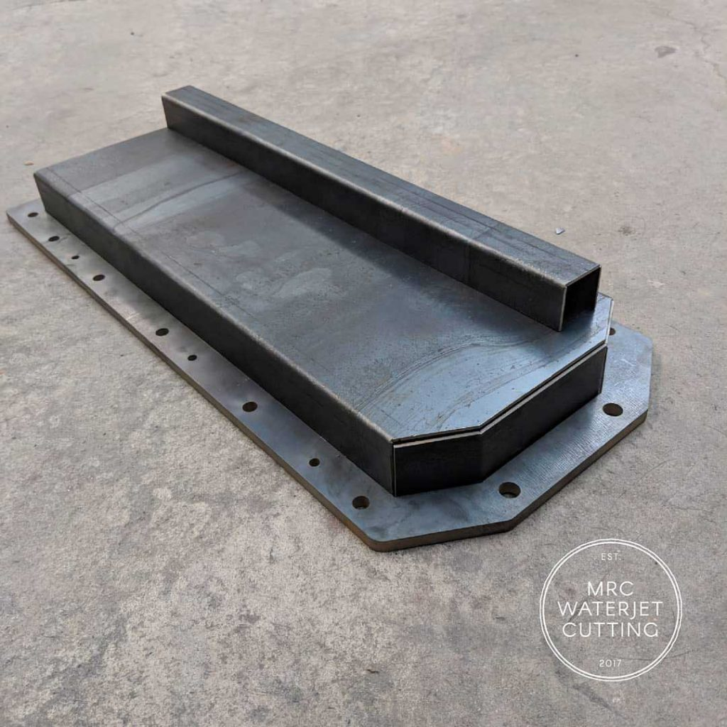 Waterjet cut and folded dry sump for a one of our customers. If you are in the custom automotive or motorsport industries you'd be surprised in what you can make with our help.