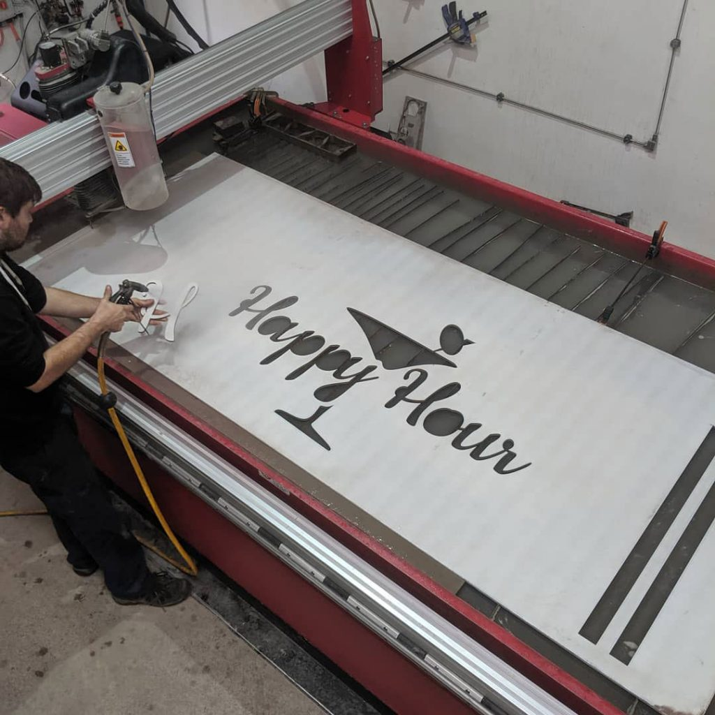 Jack cleaning off the H on this cement sheet sign