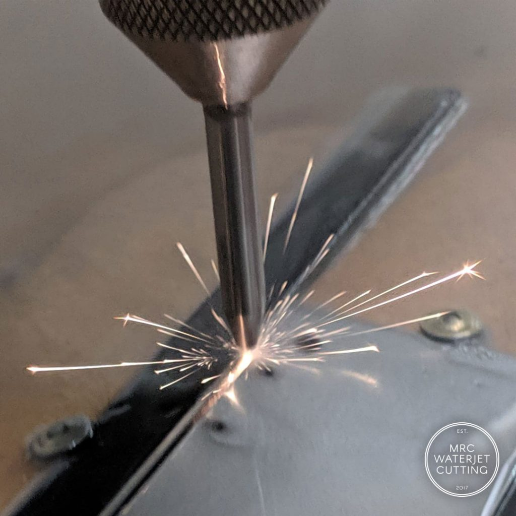 Cutting titanium plate with abrasive waterjet