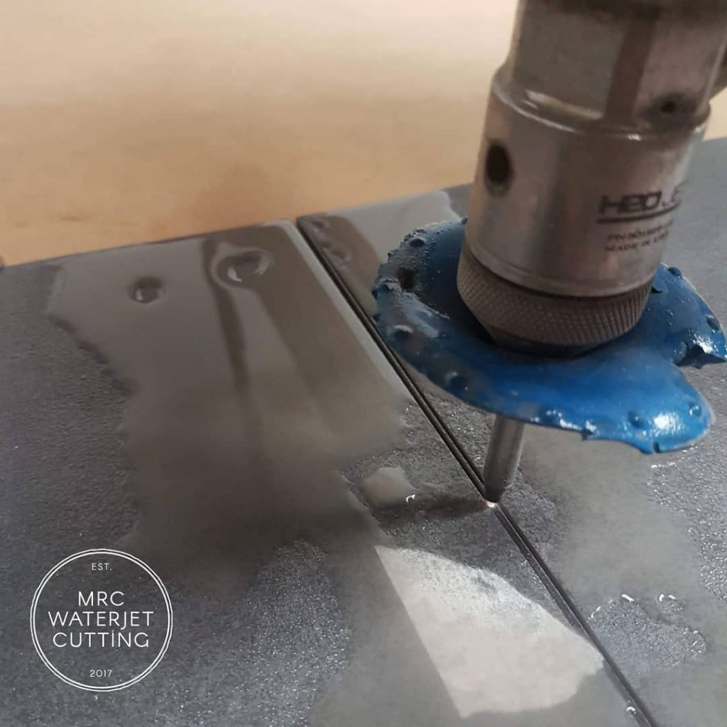 Cutting a 3mm grout line will give you a tiny slice of tile left over. This tiler marks out the cuts he needs to tile a shower base then brings them in for precision cuts. Making a complicated level floor rimless shower